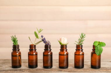 essential oil bottles with plants and flowers